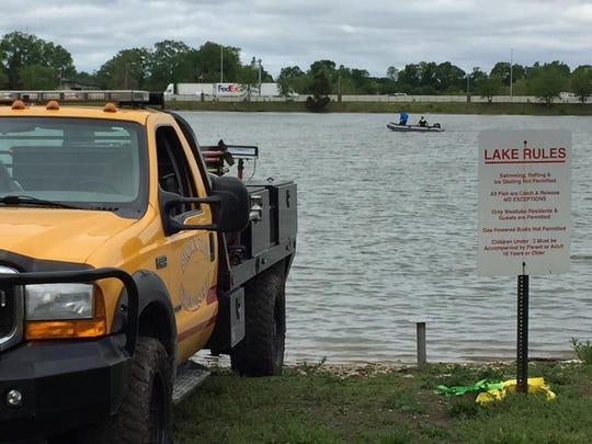 Crews search a westside pond Monday for clues in the Narah Ferrell case.