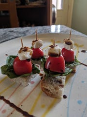 These mini caprese salads make for a fine graduation party finger food