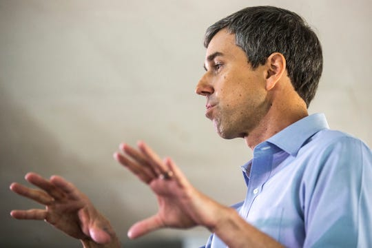 Democratic presidential candidate Beto O'Rourke speaks to a group during a campaign event, Tuesday, May 21, 2019, at City Park in Tipton, Iowa.