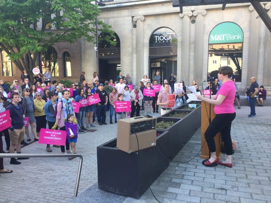 Emily of Planed Parenthood of the Southern Finger Lakes leads the crowd in chants between speakers.