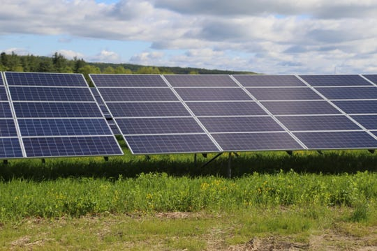 Solar panels at Newfield Community Solar Farm.