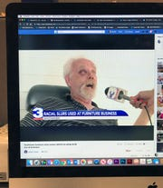 This photo of a computer screen shows a social media post with Hometown Furniture owner Terry Pace speaking to a WREG news crew.
