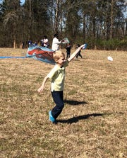 Bobby Sheffield flies a kite at Kite Day at Nova Elementary. His mom Angie Sheffield said he is active and enjoys playing outside.