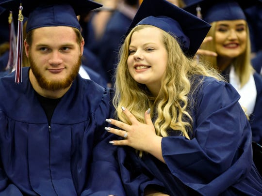 Calli Russell shows off her engagement ring with her fiance, Colby Dawson, during their Union County High School graduation ceremony at Tex Turner Arena on Monday, May 20, 2019. Colby proposed to Calli on stage as they were receiving their diplomas.