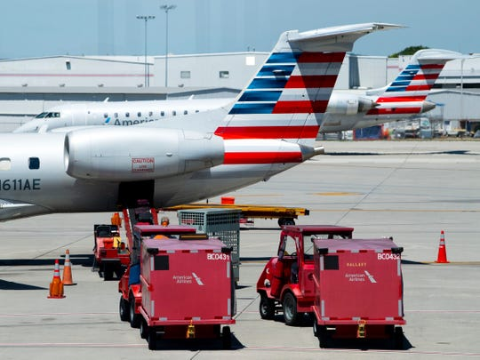 Luggage is loaded onto an American Airlines flight at McGhee Tyson Airport on Tuesday, May 21, 2019.