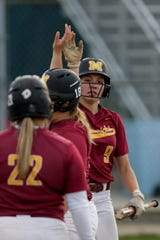 McCutcheon center fielder Kendra Hutchison (9) scores during the third inning of the first round of the 4a Girls Softball Sectional, Monday, May 20, 2019, at Harrison High School in West Lafayette. McCutcheon won, 18-2.
