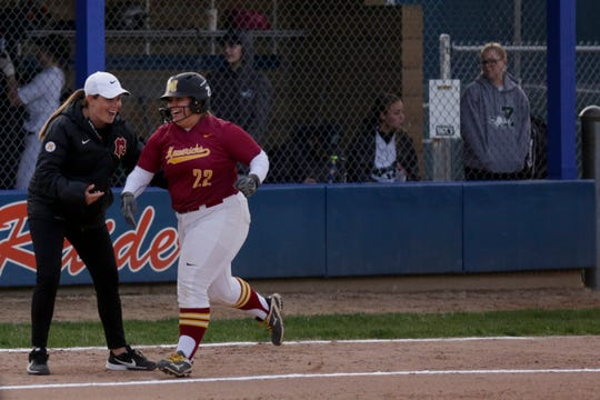 McCutcheon head coach Kelsey Wides celebrates with McCutcheon third baseman Sofia Gaeta (22) after Gaeta hit a grand slam during the first inning of the first round of the 4a Girls Softball Sectional, Monday, May 20, 2019, at Harrison High School in West Lafayette. McCutcheon won, 18-2.
