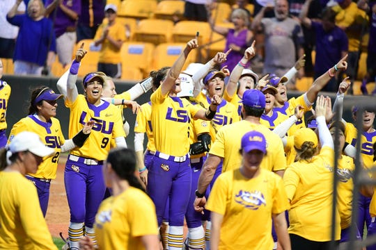 Members of the LSU softball team celebrate together.