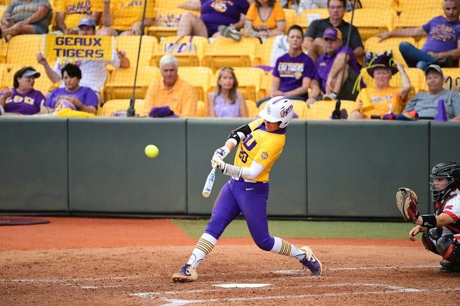 LSU softball player Amanda Sanchez (No. 20) swings at a pitch.