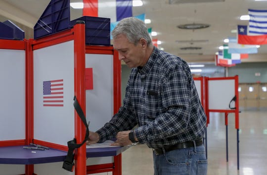 Ralph Merkel fills out his ballot at Atherton High School on Tuesday morning.  May 21, 2019