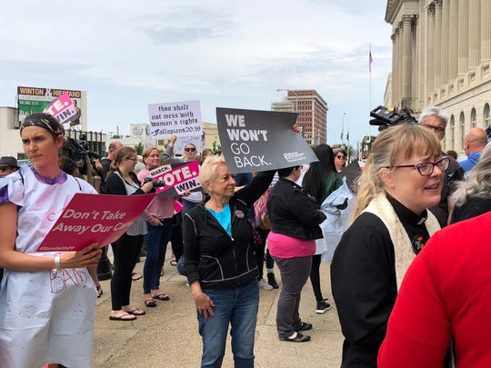 Protesters gather in downtown Louisville, Ky., for a rally against anti-abortion bills May 21.