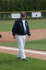 Ed Outslay, 67, died Monday after throwing batting practice at East Lansing High School. He took pride in maintaining the field for several years, especially its pitcher's mound.