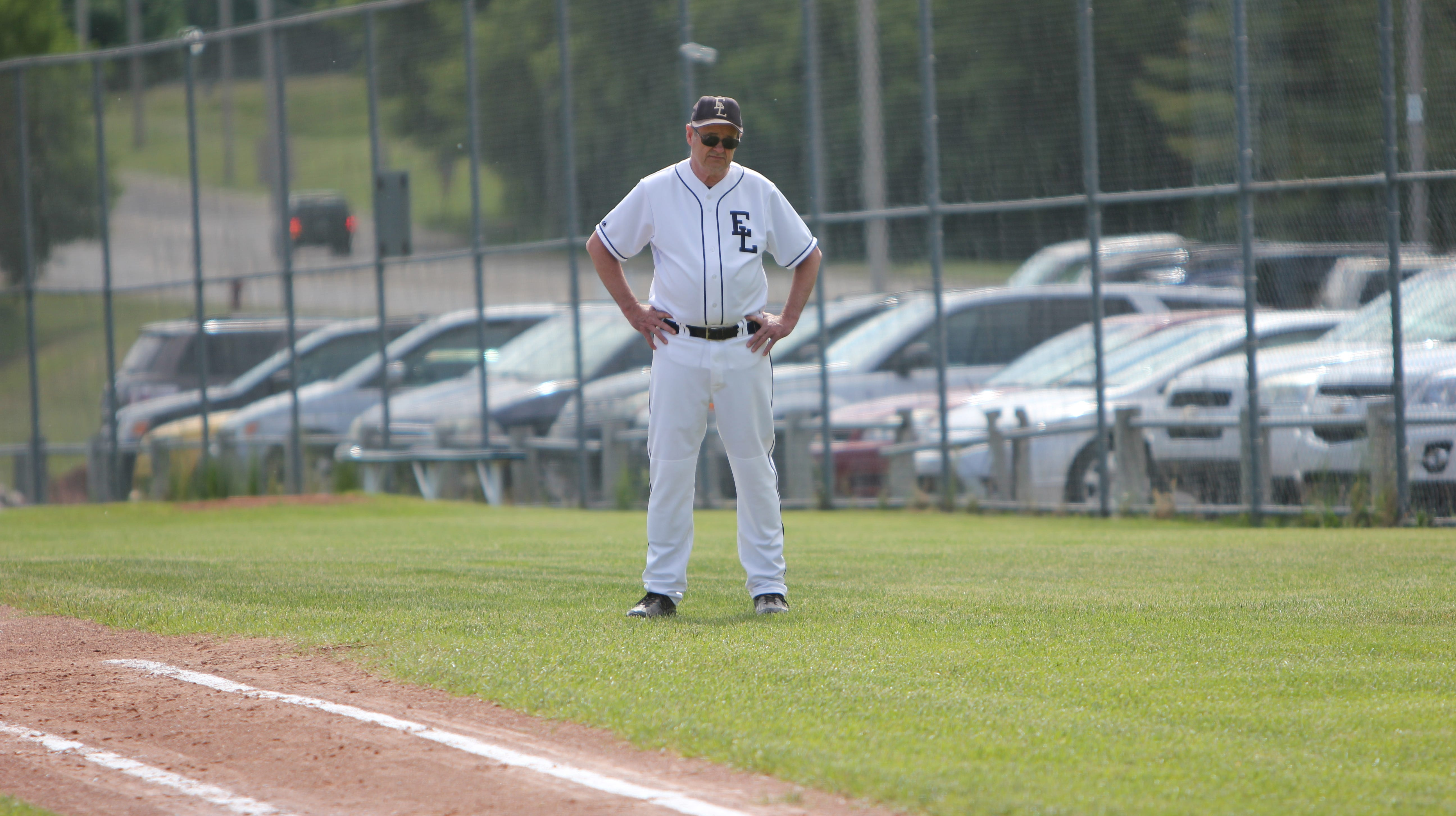 East Lansing High School assistant baseball coach dies after throwing batting practice