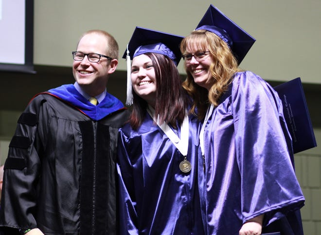 LTC President Dr. Paul Carlsen with graduating daughter mother duo Amber Hewitt and Julie Pitz at commencement May 18. Hewitt and Pitz attended college together, earning associate degrees in accounting.