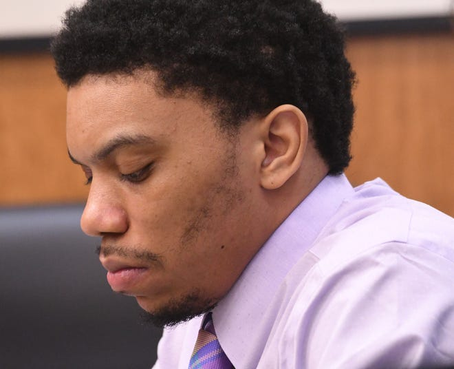 Deshawn Dowdell listens to testimony during his trial in front of Judge Brent Robinson in Richland County Common Pleas Court.