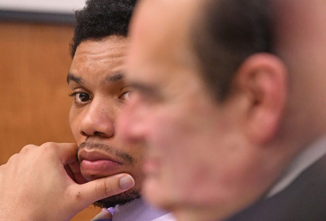 Deshawn Dowdell listens to testimony during his trial in front of Judge Brent Robinson. Dowdell, 24, is charged with murder, two counts of discharging a firearm at or near a prohibited area and improper handling of a firearm in a motor vehicle in connection with the April 2018 shooting death of Terrence Harris.
