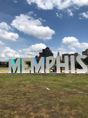 Artist with Youngblood studios were adding final touches to the new 'Memphis' sign on Mud Island.