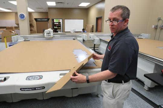 Designer Jeff Eubanks demonstrates the use of a box cutting CAD machine at International Paper's Memphis customer commitment center on Tuesday, May 21, 2019.