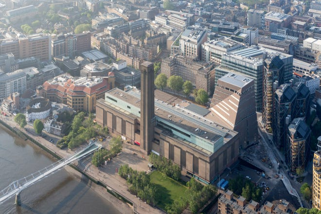 This aerial shot of the renovated Tate Modern on the Thames in London gives an example of the type of rivefront museum design previously accomplished by newly selected Brooks Museum of Art architectural firm Herzog & de Meuron.