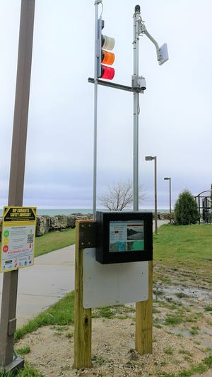 """This new """"traffic light"""" system on Port Washington's lakefront warns beach-goers about rip current conditions on Lake Michigan."""