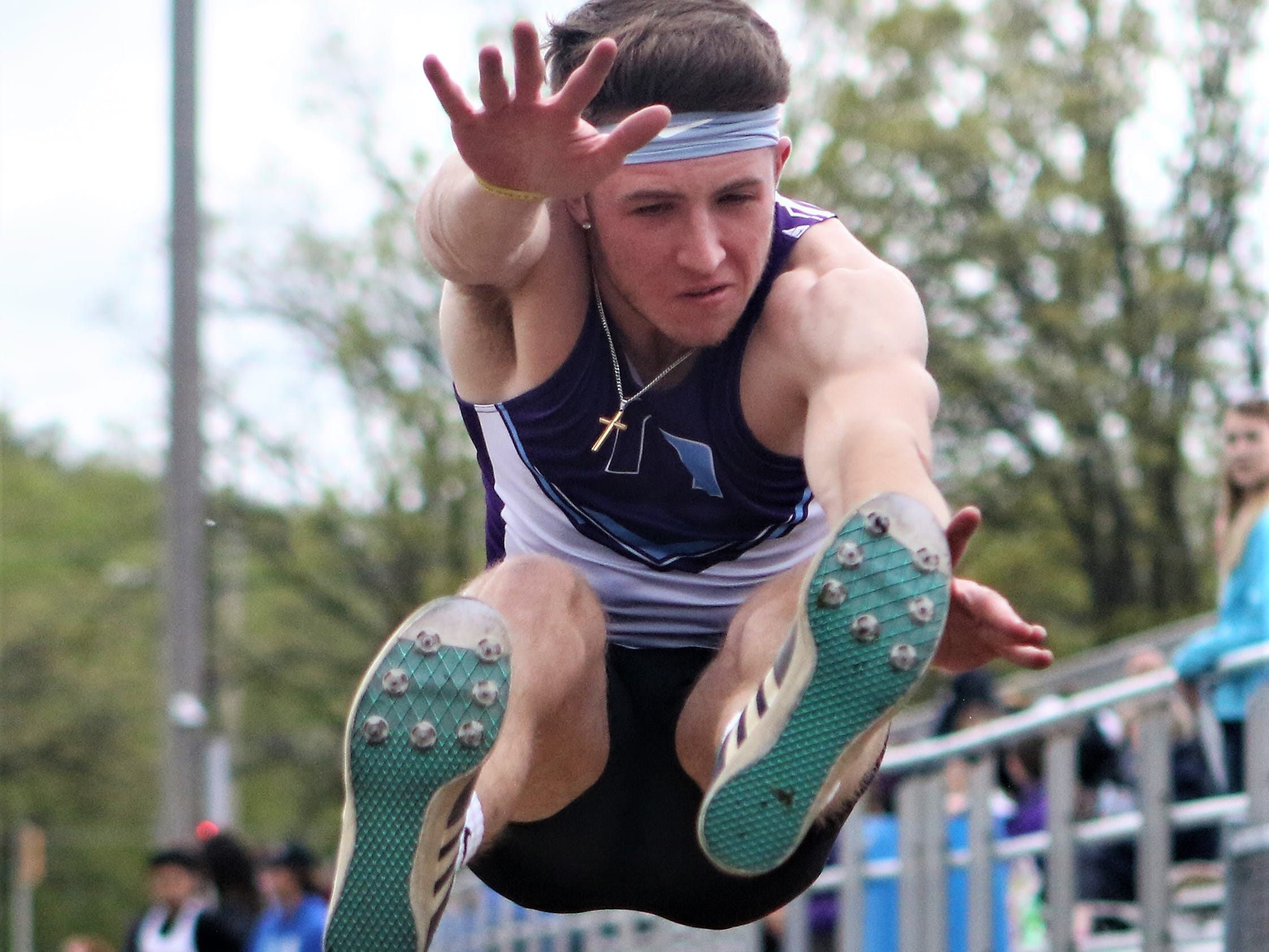 Alex Lesperance of Waukesha North vaults forward during the long jump competition at the Kettle Moraine regional on May 20, 2019.