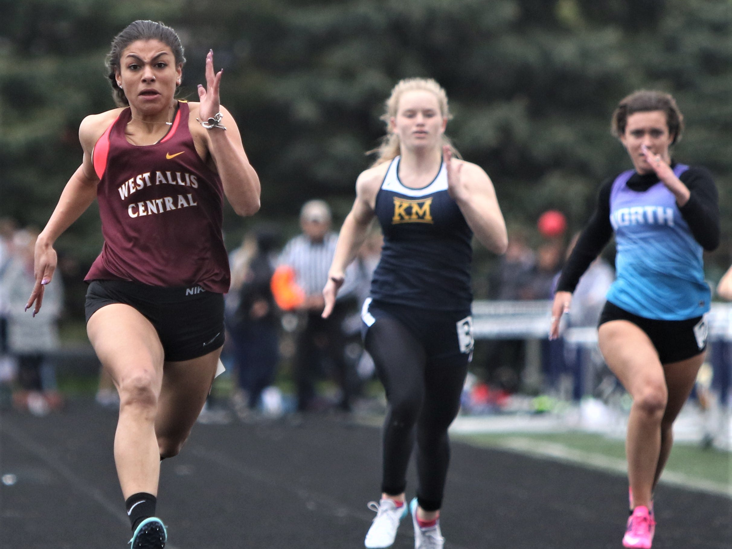 West Allis Central's Dana Hohenstein wins the 100 meter dash during the WIAA regional at Kettle Moraine on May 20, 2019.