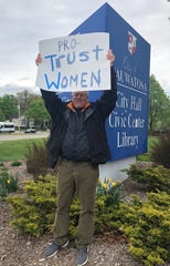 Tom Schuler of Milwaukee holds up his sign proudly on May 21 on front of Wauwatosa City Hall, 7725 W North Ave. He and over 20 people held signs during a rally. On Tuesday, supporters across the nation showed opposition towards several state laws aimed at restricting access to abortions.