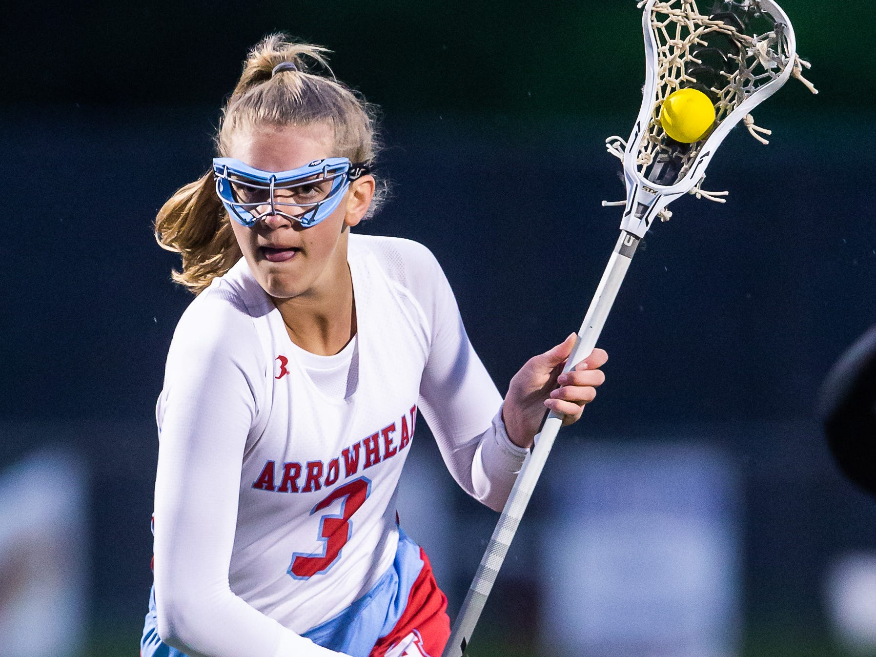 Arrowhead White's Alena Lippold (3) races in for a shot on goal during the game at home against Divine Savior Holy Angels on Friday, May 17, 2019.