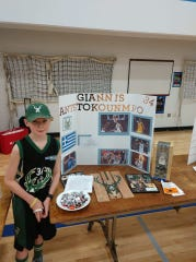 Liam Wills presents his wax museum project at Wauwatosa Catholic School on May 14. His subject was Bucks forward Giannis Antetokounmpo.