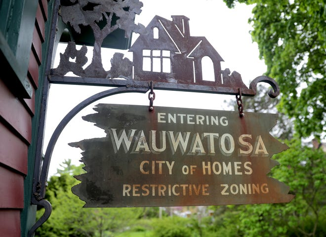 Handsomely lettered signs once hung at the city limits of Wauwatosa, meant to exclude black people from owning or occuping homes. Until recently, one hung  outside at the Wauwatosa Historical Society, which took it down in May after an inquiry from the Journal Sentinel.