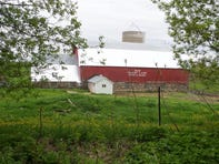 The Shady Lane Stock Farm in Cadott, Wisconsin, includes a barn and milk house, where fourth-generation farmer Thomas Jackson used to milk his herd of about 40 cows.