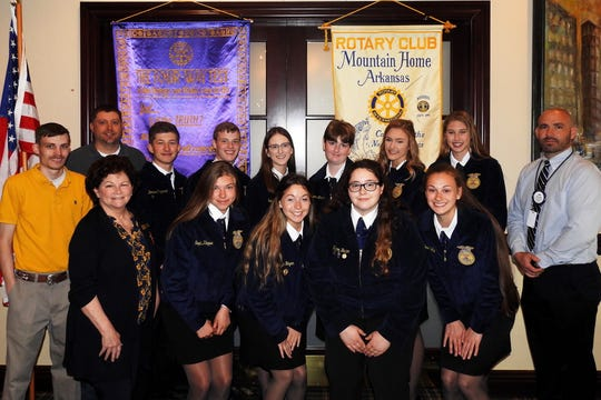 The Mountain Home High School FFA and Agri Department were recently the invited guests of the Mountain Home Rotary Club.  At the meeting, the young people told about their chapter's Arkansas Championship Award, they presented a demonstration by  the debate/parliamentary team, and previewed their new 30 x 90-foot greenhouse. Pictured are: (first row, from left) Rotarian Nita Davis, Sophie Kleppe, Cheyenne Hogan, Peyton Barton, Josie Kelly; (second row) teacher Brandon Lewis, teacher Josh Baker, Dominic Pizzimenti, Daxton Hickman, Kelsey Rohr, Aspen Thomas, Madison Smith, Chloe Nosari and Rotarian/Mountain Home Superintendent Dr. Jake Long. Within the past month, the students held a plant and vegetable sale at the completely-full greenhouse, which sold out in three days, including their donation of fresh produce to the local food bank.