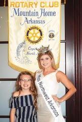 "Miss Northwest Arkansas Alexis Ungerank recently spoke to the Rotary Club of Mountain Home about the ""Miss Arkansas"" scholarship contest in June. Last year, she represented northeastern Arkansas in the state competition and placed in the top 15, with a goal of making at least the top 10 this year. Ungerank is pictured with Isabella Sanders, daughter of Steven and Danielle Sanders of Mountain Home, who is Ungerank's ""Miss Northwest Arkansas Princess."" Ungerank's platform is ""Living the Gold Standard"" — applying the Bible's Golden Rule in interacting with others and being a positive role model.  Her dance talent has already helped her win $8,000 in scholarships over the past year that she is using toward her education. The daughter of Mark and Hazel Ungerank, Ungerank is a student at the University of Arkansas where she is a business major and a member of the Dance Squad for all U of A sporting events."