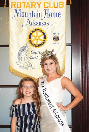 """Miss Northwest Arkansas Alexis Ungerankrecently spoke to the Rotary Club of Mountain Home about the """"Miss Arkansas"""" scholarship contest in June.Last year, she represented northeastern Arkansas in the state competition and placed in the top 15, with a goal of making at least the top 10this year. Ungerank is pictured with Isabella Sanders, daughter of Steven and Danielle Sanders of Mountain Home, who is Ungerank's """"Miss Northwest Arkansas Princess."""" Ungerank's platform is """"Living the Gold Standard"""" —applying the Bible's Golden Rule in interacting with others and being a positive role model. Her dance talent has already helped her win $8,000 in scholarships over the past year that she is using toward her education.The daughter of Mark and Hazel Ungerank, Ungerank is a student at the University of Arkansas where she is a business major and a member of the Dance Squad for all U of A sporting events."""