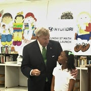 Mayor Todd Strange talks with a Catoma Elementary student during an event to present a $250,000 donation from Hyundai to Montgomery Public Schools on Tuesday, May 21.