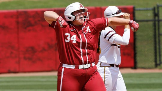 Alabama softball player Caroline Hardy (No. 34) celebrates on the base path.