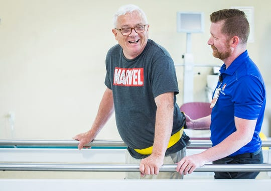 Jeff Watters participates in a physical therapy session with therapist Michael Lewellen at IU Health Outpatient and Rehab in Muncie. Watters lost his mobility after becoming infected with the West Nile virus.