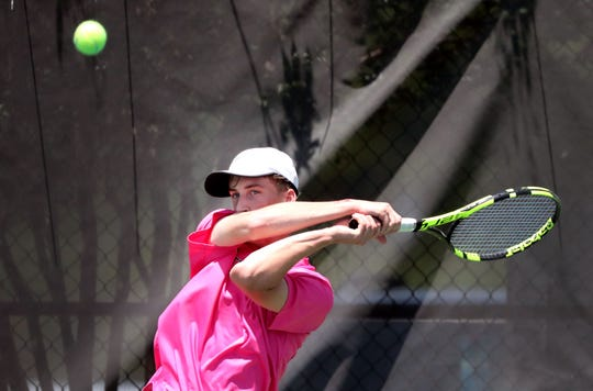 Ryan Harper of Central Magnet returns the ball during the Large Class State Boys Team Tennis Tournament against White Station on Tuesday, May 21, 2019.