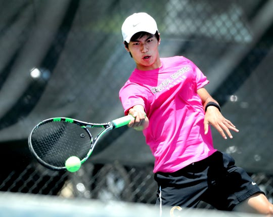 Nathan Zou of Central Magnet returns the ball during the Large Class State Boys Team Tennis Tournament against White Station on Tuesday, May 21, 2019.