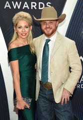 Cody Johnson arrives with his wife, Brandi, for the 52nd annual CMA Awards show Nov. 14, 2018, at Bridgestone Arena in Nashville.