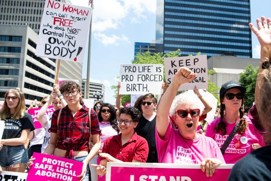 Protesters cheer for speakers against anti-abortion legislation at Legislative Plaza Tuesday, May 21, 2019, in Nashville, Tenn.
