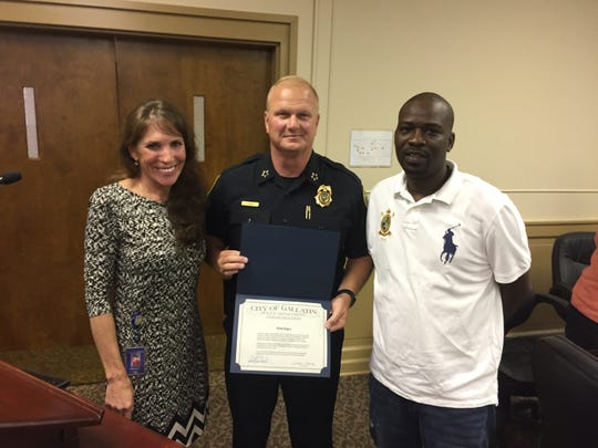 Gallatin Mayor Paige Brown and Police Chief Don Bandy recognize citizen Randy Rogers for helping a man escape his burning vehicle last month.
