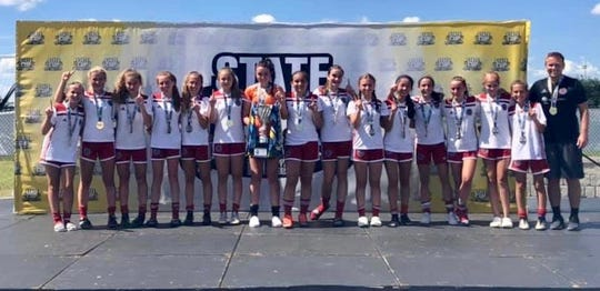 The Florida Fire Juniors U14 girls won the FYSA State Cup in Auburndale this past weekend. The Fire are coached by Chris Cashion, far right. Members of the team are: Edin Abougzir, Alexandra Blose, Adeline Brown, Madison Connaway, Morgan King, Cameron Levantini, Annika Lindquist, Elaina Loden, Ansley Mancini, Hana Markovic, Caprice Morely, Caitlyn Rogers, Briana Shimer, Molly Vickaryous and Madilyn Winn.