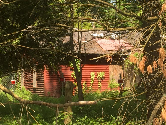 This house that faces Newark-Granville Road has been unoccupied since at least 2008, Village officials say.