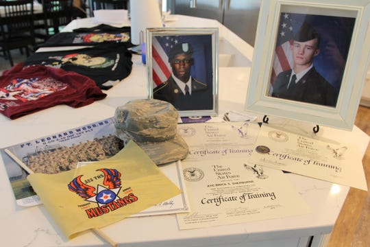 Memorabilia from Andre Manning (left) and Brice Sherburne's basic training is displayed at the Heath home on Tuesday, May 21, 2019.