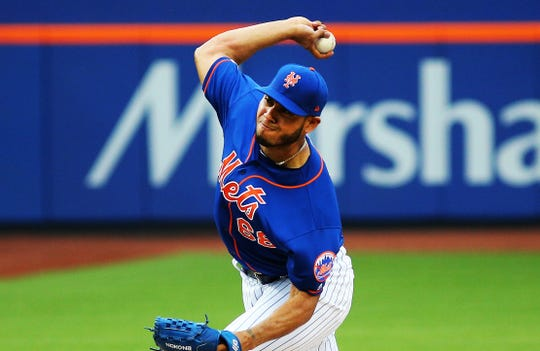 New York Mets starting pitcher Wilmer Font (68) delivers a pitch against the Washington Nationals during the first inning at Citi Field.
