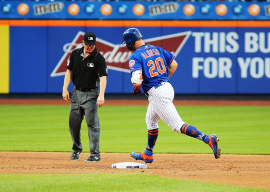 New York Mets first baseman Pete Alonso (20) rounds the bases after hitting a solo home run against the Washington Nationals during the first inning at Citi Field.