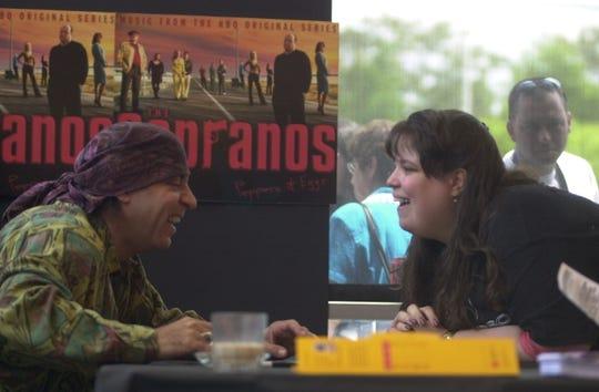 Stevie Van Zandt signs a CD for fan Jodi Freda of Bloomfield on May 19, 2001.