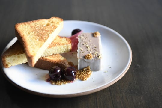 Chicken liver mousse, served with preserved cherries, pickled red onion, mustard seeds, and toasted brioche. Prepared by Lauren Hirschberg, chef and owner of Turtle + the Wolf.