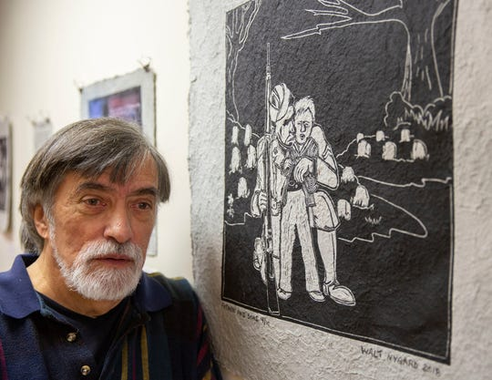 """Walter Nygard, exhibiting his piece """"Fathers and Sons,"""" done on Frontline Paper, at the Puffin Institute in 2018"""